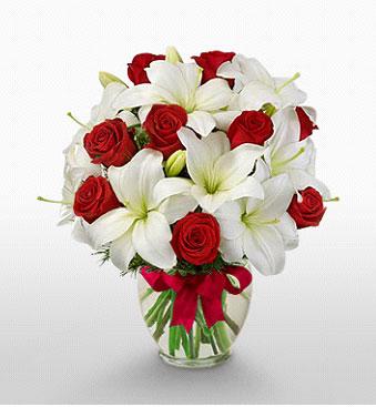 Adana hediye çiçek yolla  1 dal kazablanka 11 adet kırmızı gül vazosu